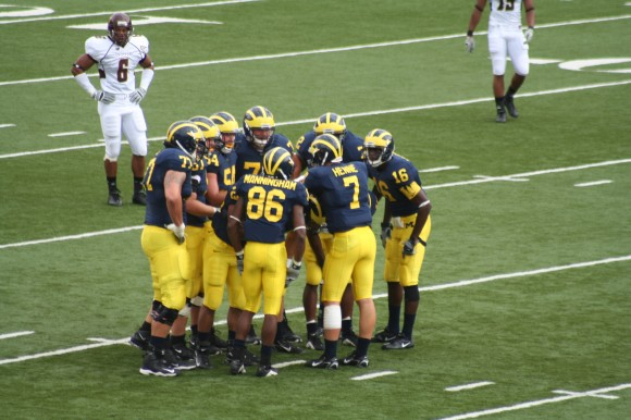 University of Michigan football huddle